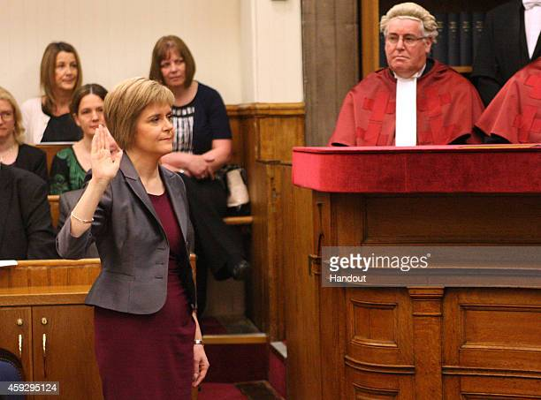 In this handout image made available by Lesley Donald Photography SNP leader Nicola Sturgeon is formally sworn in as Scotland's first minister in...
