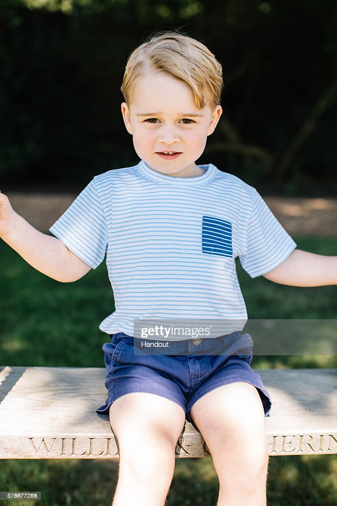 In this handout image of four released on July 22, 2016 by the Duke and Duchess of Cambridge, Prince Prince George of Cambridge is seen on a swing ahead of his third birthday at the family's Norfolk home in mid July 2016. . This photograph is provided to you strictly on condition that you will make no charge for the supply, release or publication of it and that these conditions and restrictions will apply (and that you will pass these on) to any organisation to whom you supply it. All other requests for use should be directed to the Press Office at Kensington Palace in writing.
