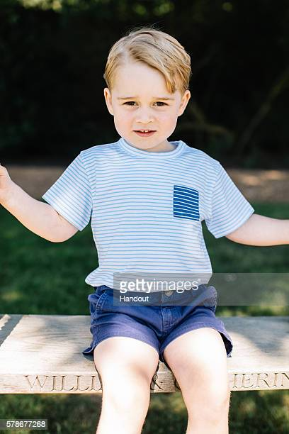 In this handout image of four released on July 22 2016 by the Duke and Duchess of Cambridge Prince Prince George of Cambridge is seen on a swing...