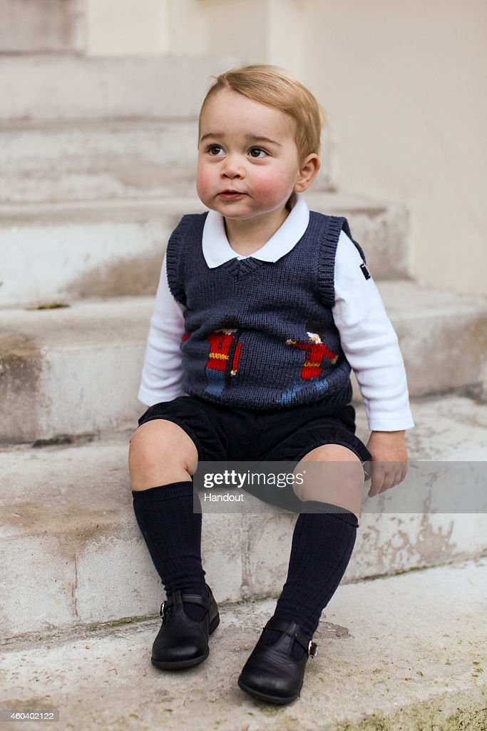 In this handout image of three released on December 13 2014 by Kensington Palace Prince George sits for his official Christmas picture in a courtyard...