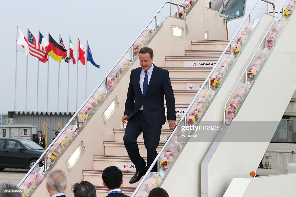 In this handout image provide by Foreign Ministry of Japan, Britain's Prime Minister <a gi-track='captionPersonalityLinkClicked' href=/galleries/search?phrase=David+Cameron+-+Politicus&family=editorial&specificpeople=227076 ng-click='$event.stopPropagation()'>David Cameron</a> is seen upon arrival at the Chubu Centrair International Airport on May 25, 2016 in Nagoya, Japan. In the two-day summit held on May 26 and 27, the G7 leaders are scheduled to discuss the pressing global issues including counter-terrorism, energy policy, and sustainable development.