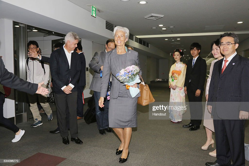 In this handout image provide by Foreign Ministry of Japan, Christine Lagarde (C), the managing director of International Monetary Fund, is seen upon arrival ahead of the G7 Japan 2016 at the Chubu Centrair International Airport on May 25, 2016 in Nagoya, Japan. In the two-day summit held on May 26 and 27, the G7 leaders are scheduled to discuss the pressing global issues including counter-terrorism, energy policy, and sustainable development.