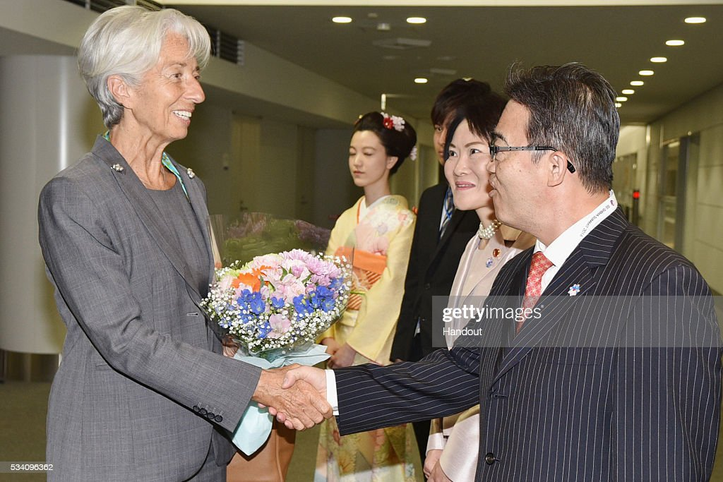 In this handout image provide by Foreign Ministry of Japan, <a gi-track='captionPersonalityLinkClicked' href=/galleries/search?phrase=Christine+Lagarde&family=editorial&specificpeople=566337 ng-click='$event.stopPropagation()'>Christine Lagarde</a> (L), the managing director of International Monetary Fund, is seen welcomed by Aichi Prefectural governor Hideaki Omura (R) upon arrival ahead of the G7 Japan 2016 at the Chubu Centrair International Airport on May 25, 2016 in Nagoya, Japan. In the two-day summit held on May 26 and 27, the G7 leaders are scheduled to discuss the pressing global issues including counter-terrorism, energy policy, and sustainable development.