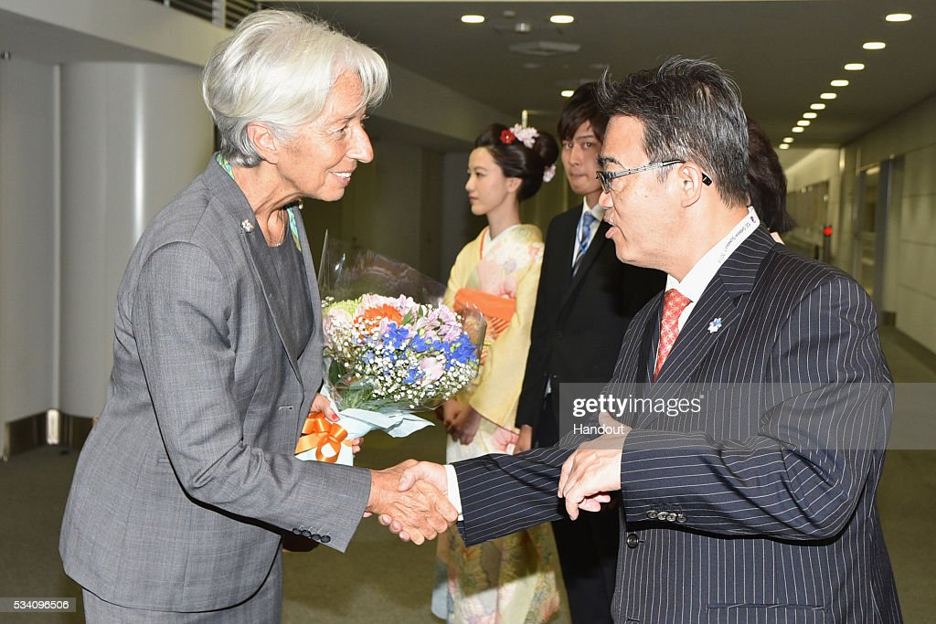 In this handout image provide by Foreign Ministry of Japan, Christine Lagarde (L), the managing director of International Monetary Fund, is seen welcomed by Aichi Prefectural governor Hideaki Omura (R) upon arrival ahead of the G7 Japan 2016 at the Chubu Centrair International Airport on May 25, 2016 in Nagoya, Japan. In the two-day summit held on May 26 and 27, the G7 leaders are scheduled to discuss the pressing global issues including counter-terrorism, energy policy, and sustainable development.