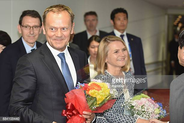 In this handout image provide by Foreign Ministry of Japan European Council President Donald Tusk and wife Malgorzata Tusk are seen upon arrival at...