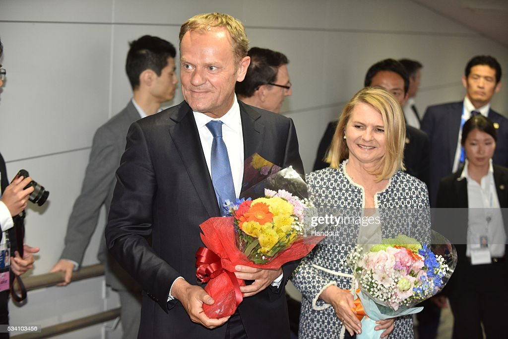 In this handout image provide by Foreign Ministry of Japan, European Council President Donald Tusk (L) and wife Malgorzata Tusk (R) are seen upon arrival at the Chubu Centrair International Airport on May 25, 2016 in Nagoya, Japan. In the two-day summit held on May 26 and 27, the G7 leaders are scheduled to discuss the pressing global issues including counter-terrorism, energy policy, and sustainable development.