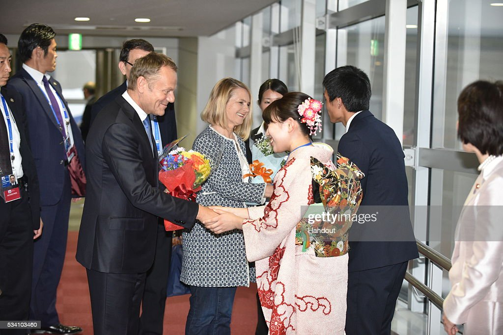 In this handout image provide by Foreign Ministry of Japan, European Council President <a gi-track='captionPersonalityLinkClicked' href=/galleries/search?phrase=Donald+Tusk&family=editorial&specificpeople=870281 ng-click='$event.stopPropagation()'>Donald Tusk</a> (L) and wife Malgorzata Tusk (R) are seen upon arrival at the Chubu Centrair International Airport on May 25, 2016 in Nagoya, Japan. In the two-day summit held on May 26 and 27, the G7 leaders are scheduled to discuss the pressing global issues including counter-terrorism, energy policy, and sustainable development.