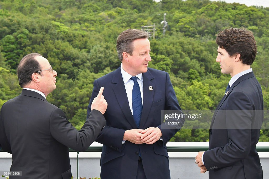 In this handout image provide by Foreign Ministry of Japan, (L to R) French President Francois Hollande, British Prime Minister <a gi-track='captionPersonalityLinkClicked' href=/galleries/search?phrase=David+Cameron+-+Politician&family=editorial&specificpeople=227076 ng-click='$event.stopPropagation()'>David Cameron</a> and Canadian Prime Minister <a gi-track='captionPersonalityLinkClicked' href=/galleries/search?phrase=Justin+Trudeau&family=editorial&specificpeople=2616495 ng-click='$event.stopPropagation()'>Justin Trudeau</a> talk before a family photo at the Shima Kanko Hotel on May 26, 2016 in Kashikojima, Japan. In the two-day summit, the G7 leaders are scheduled to discuss the pressing global issues including counter-terrorism, energy policy, and sustainable development.