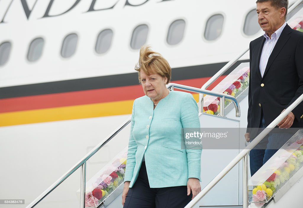 In this handout image provide by Foreign Ministry of Japan German Chancellor Angela Merkel is seen upon arrival at the Chubu Centrair International...