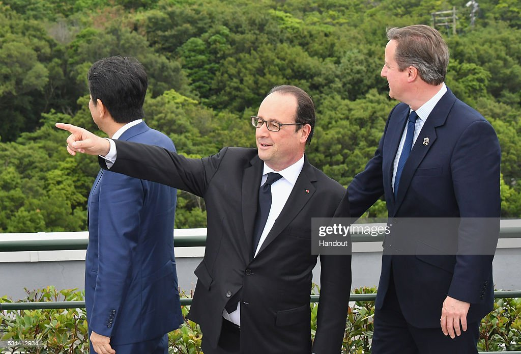 In this handout image provide by Foreign Ministry of Japan, (L to R) Japanese Prime Minister <a gi-track='captionPersonalityLinkClicked' href=/galleries/search?phrase=Shinzo+Abe&family=editorial&specificpeople=559017 ng-click='$event.stopPropagation()'>Shinzo Abe</a>, French President Francois Hollande and British Prime Minister <a gi-track='captionPersonalityLinkClicked' href=/galleries/search?phrase=David+Cameron+-+Politician&family=editorial&specificpeople=227076 ng-click='$event.stopPropagation()'>David Cameron</a> talk before a family photo session at the Shima Kanko Hotel on May 26, 2016 in Kashikojima, Japan. In the two-day summit, the G7 leaders are scheduled to discuss the pressing global issues including counter-terrorism, energy policy, and sustainable development.