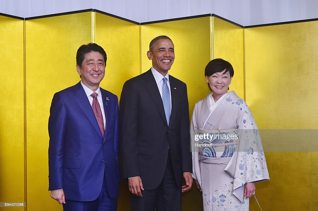In this handout image provide by Foreign Ministry of Japan, Japanese U.S. President Barack Obama (C), Japan Prime Minister Shinzo Abe (L) and wife Akie Abe (R) attend the cocktail event during the G7 Japan 2016 Ise-Shima summit at the Shima Kanko Hotel on May 26, 2016 in Kashikojima, Japan. In the two-day summit, the G7 leaders are scheduled to discuss the pressing global issues including counter-terrorism, energy policy, and sustainable development.