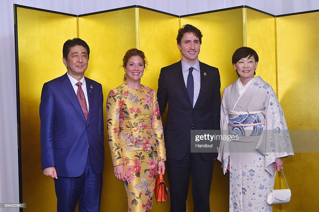 In this handout image provide by Foreign Ministry of Japan, Japanese Prime Minister <a gi-track='captionPersonalityLinkClicked' href=/galleries/search?phrase=Shinzo+Abe&family=editorial&specificpeople=559017 ng-click='$event.stopPropagation()'>Shinzo Abe</a> and wife <a gi-track='captionPersonalityLinkClicked' href=/galleries/search?phrase=Akie+Abe&family=editorial&specificpeople=2042808 ng-click='$event.stopPropagation()'>Akie Abe</a> (R), Canadian Prime Minister <a gi-track='captionPersonalityLinkClicked' href=/galleries/search?phrase=Justin+Trudeau&family=editorial&specificpeople=2616495 ng-click='$event.stopPropagation()'>Justin Trudeau</a> (2nd R) and wife Sophie Gregoire-Trudeau (2nd L) attend the cocktail event during the G7 Japan 2016 Ise-Shima summit at the Shima Kanko Hotel on May 26, 2016 in Kashikojima, Japan. In the two-day summit, the G7 leaders are scheduled to discuss the pressing global issues including counter-terrorism, energy policy, and sustainable development.