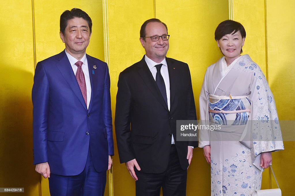 In this handout image provide by Foreign Ministry of Japan, Japanese Prime Minister Shinzo Abe (L), French President Francois Hollande (C) and Akie Abe (R) attend the cocktail event during the G7 Japan 2016 Ise-Shima summit at the Shima Kanko Hotel on May 26, 2016 in Kashikojima, Japan. In the two-day summit, the G7 leaders are scheduled to discuss the pressing global issues including counter-terrorism, energy policy, and sustainable development.