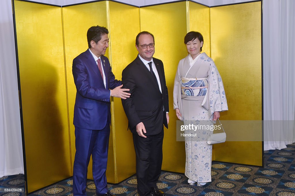In this handout image provide by Foreign Ministry of Japan, Japanese Prime Minister <a gi-track='captionPersonalityLinkClicked' href=/galleries/search?phrase=Shinzo+Abe&family=editorial&specificpeople=559017 ng-click='$event.stopPropagation()'>Shinzo Abe</a> (L), French President Francois Hollande (C) and <a gi-track='captionPersonalityLinkClicked' href=/galleries/search?phrase=Akie+Abe&family=editorial&specificpeople=2042808 ng-click='$event.stopPropagation()'>Akie Abe</a> (R) attend the cocktail event during the G7 Japan 2016 Ise-Shima summit at the Shima Kanko Hotel on May 26, 2016 in Kashikojima, Japan. In the two-day summit, the G7 leaders are scheduled to discuss the pressing global issues including counter-terrorism, energy policy, and sustainable development.