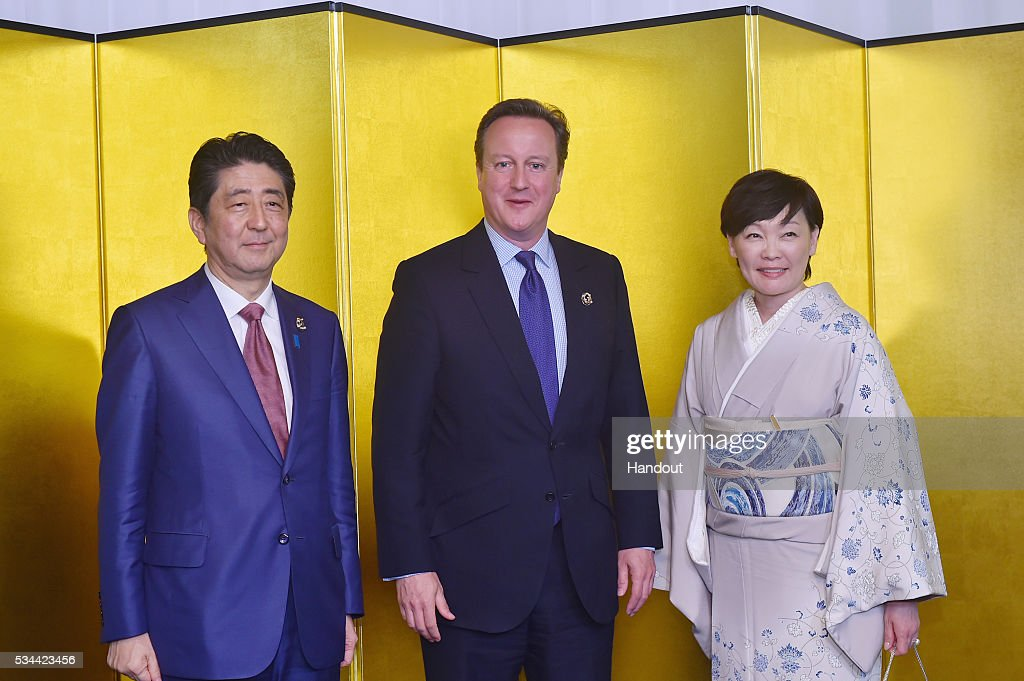 In this handout image provide by Foreign Ministry of Japan, Japanese Prime Minister Shinzo Abe (L), British Prime Minister David Cameron (C) and Akie Abe (R) attend the cocktail event during the G7 Japan 2016 Ise-Shima summit at the Shima Kanko Hotel on May 26, 2016 in Kashikojima, Japan. In the two-day summit, the G7 leaders are scheduled to discuss the pressing global issues including counter-terrorism, energy policy, and sustainable development.
