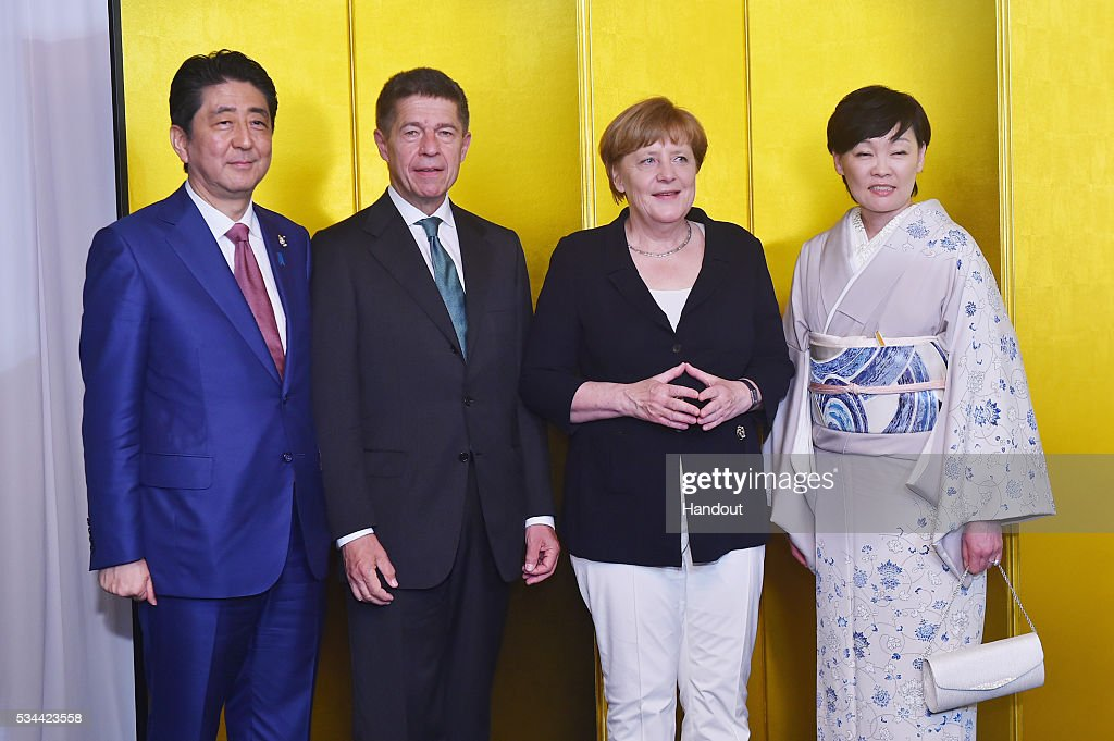 In this handout image provide by Foreign Ministry of Japan, (L-R) Japanese Prime Minister Shinzo Abe, Joachim Sauer, German Chancellor Angela Merkel and Akie Abe attend the cocktail event during the G7 Japan 2016 Ise-Shima summit at the Shima Kanko Hotel on May 26, 2016 in Kashikojima, Japan. In the two-day summit, the G7 leaders are scheduled to discuss the pressing global issues including counter-terrorism, energy policy, and sustainable development.