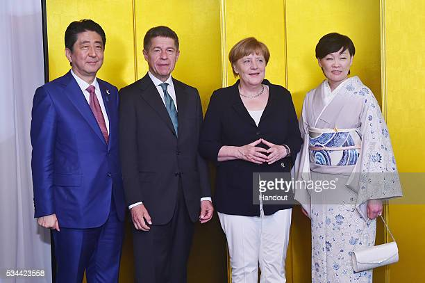 In this handout image provide by Foreign Ministry of Japan Japanese Prime Minister Shinzo Abe Joachim Sauer German Chancellor Angela Merkel and Akie...