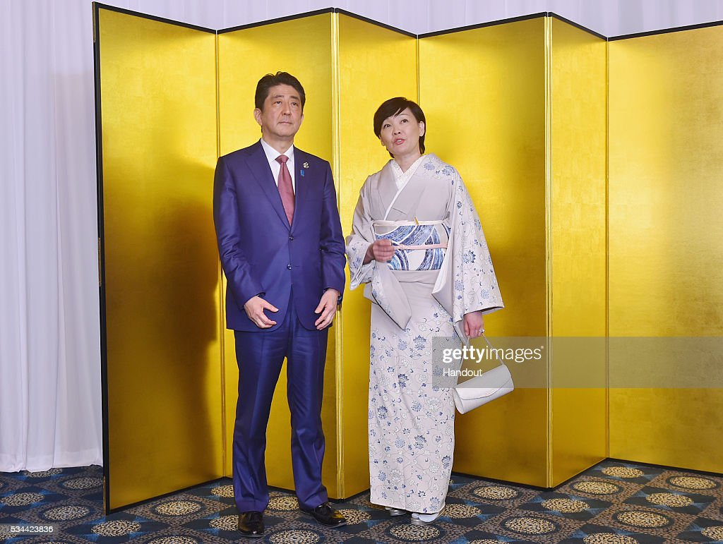 In this handout image provide by Foreign Ministry of Japan, Japanese Prime Minister <a gi-track='captionPersonalityLinkClicked' href=/galleries/search?phrase=Shinzo+Abe&family=editorial&specificpeople=559017 ng-click='$event.stopPropagation()'>Shinzo Abe</a> (L) and wife <a gi-track='captionPersonalityLinkClicked' href=/galleries/search?phrase=Akie+Abe&family=editorial&specificpeople=2042808 ng-click='$event.stopPropagation()'>Akie Abe</a> attend the cocktail event during the G7 Japan 2016 Ise-Shima summit at the Shima Kanko Hotel on May 26, 2016 in Kashikojima, Japan. In the two-day summit, the G7 leaders are scheduled to discuss the pressing global issues including counter-terrorism, energy policy, and sustainable development.