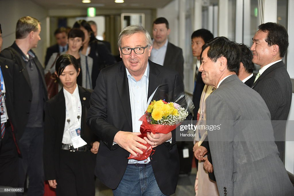 In this handout image provide by Foreign Ministry of Japan, President Of European Commission <a gi-track='captionPersonalityLinkClicked' href=/galleries/search?phrase=Jean-Claude+Juncker&family=editorial&specificpeople=207032 ng-click='$event.stopPropagation()'>Jean-Claude Juncker</a> (C) is seen upon arrival at the Chubu Centrair International Airport on May 25, 2016 in Nagoya, Japan. In the two-day summit held on May 26 and 27, the G7 leaders are scheduled to discuss the pressing global issues including counter-terrorism, energy policy, and sustainable development.