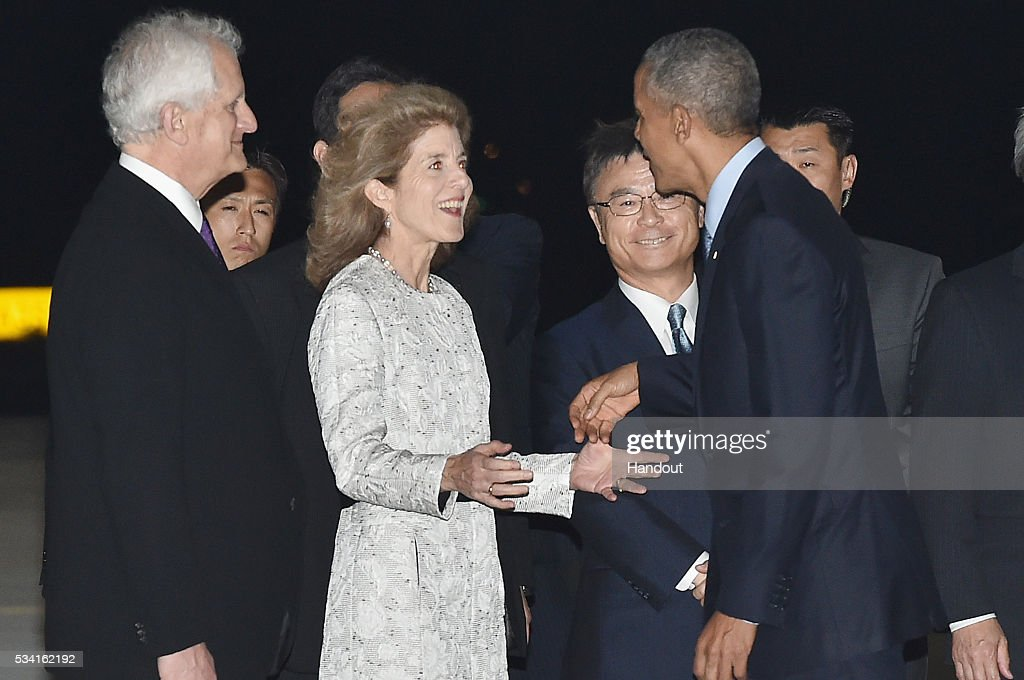 In this handout image provide by Foreign Ministry of Japan, U.S. President <a gi-track='captionPersonalityLinkClicked' href=/galleries/search?phrase=Barack+Obama&family=editorial&specificpeople=203260 ng-click='$event.stopPropagation()'>Barack Obama</a> (R) is seen welcomed by U.S. Ambassador <a gi-track='captionPersonalityLinkClicked' href=/galleries/search?phrase=Caroline+Kennedy&family=editorial&specificpeople=93208 ng-click='$event.stopPropagation()'>Caroline Kennedy</a> (C) and her husband <a gi-track='captionPersonalityLinkClicked' href=/galleries/search?phrase=Ed+Schlossberg&family=editorial&specificpeople=963221 ng-click='$event.stopPropagation()'>Ed Schlossberg</a> (L) upon arrival at the Chubu Centrair International Airport on May 25, 2016 in Nagoya, Japan. In the two-day summit held on May 26 and 27, the G7 leaders are scheduled to discuss the pressing global issues including counter-terrorism, energy policy, and sustainable development.