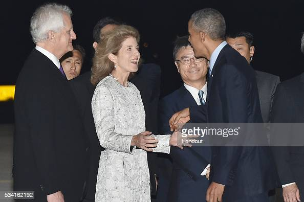 In this handout image provide by Foreign Ministry of Japan US President Barack Obama is seen welcomed by US Ambassador Caroline Kennedy and her...