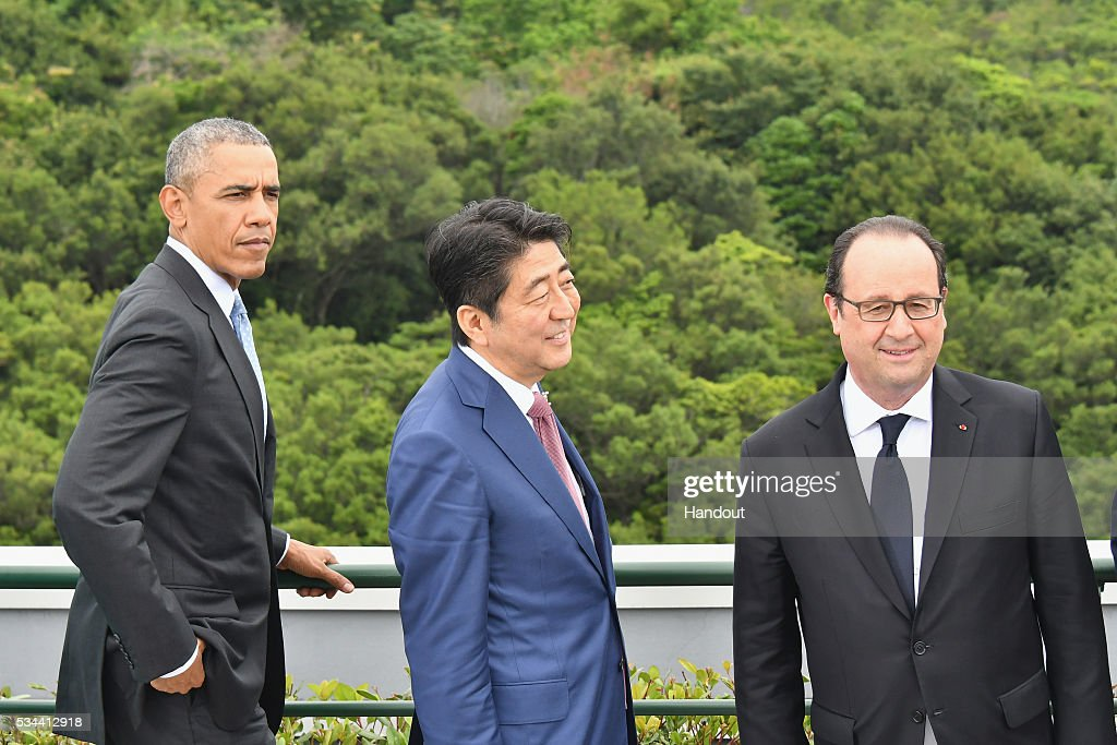 In this handout image provide by Foreign Ministry of Japan, (L to R) U.S. President <a gi-track='captionPersonalityLinkClicked' href=/galleries/search?phrase=Barack+Obama&family=editorial&specificpeople=203260 ng-click='$event.stopPropagation()'>Barack Obama</a>, Japanese Prime Minister <a gi-track='captionPersonalityLinkClicked' href=/galleries/search?phrase=Shinzo+Abe&family=editorial&specificpeople=559017 ng-click='$event.stopPropagation()'>Shinzo Abe</a>, French President Francois Hollande talk before a family photo at the Shima Kanko Hotel on May 26, 2016 in Kashikojima, Japan. In the two-day summit, the G7 leaders are scheduled to discuss the pressing global issues including counter-terrorism, energy policy, and sustainable development.