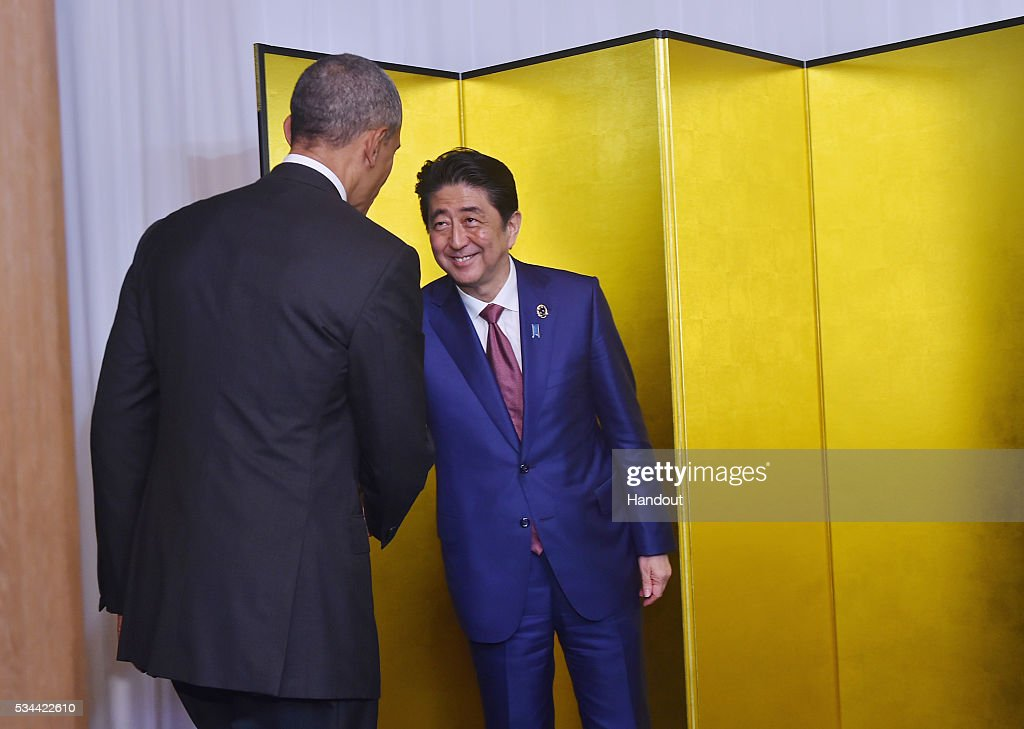 In this handout image provide by Foreign Ministry of Japan, U.S. President <a gi-track='captionPersonalityLinkClicked' href=/galleries/search?phrase=Barack+Obama&family=editorial&specificpeople=203260 ng-click='$event.stopPropagation()'>Barack Obama</a> (L) shakes hands with Japanese Prime Minister <a gi-track='captionPersonalityLinkClicked' href=/galleries/search?phrase=Shinzo+Abe&family=editorial&specificpeople=559017 ng-click='$event.stopPropagation()'>Shinzo Abe</a> (R) at the cocktail event during the G7 Japan 2016 Ise-Shima summit at the Shima Kanko Hotel on May 26, 2016 in Kashikojima, Japan. In the two-day summit, the G7 leaders are scheduled to discuss the pressing global issues including counter-terrorism, energy policy, and sustainable development.