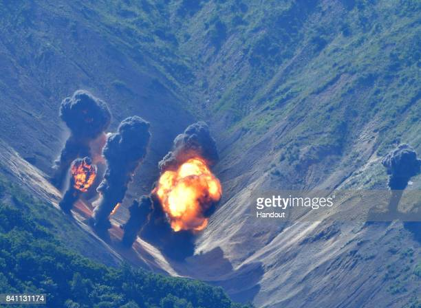 In this handout image provide by South Korean Defense Ministry Bombs hit mock target at the Pilseung Firing Range on August 31 2017 in Gangwondo...