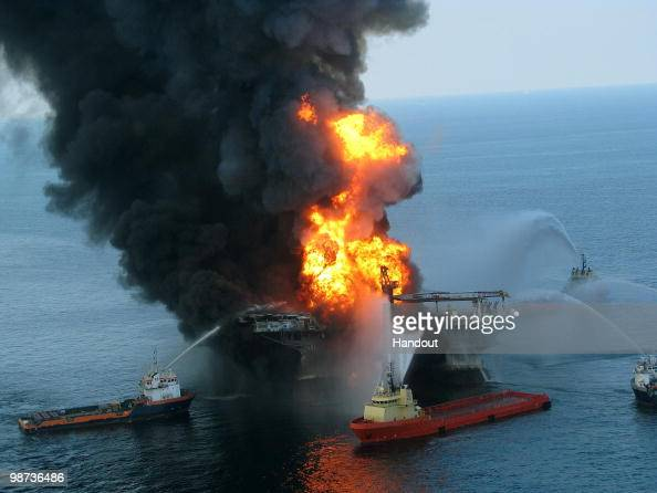 In this handout image provided be the US Coast Guard fire boat response crews battle the blazing remnants of the off shore oil rig Deepwater Horizon...