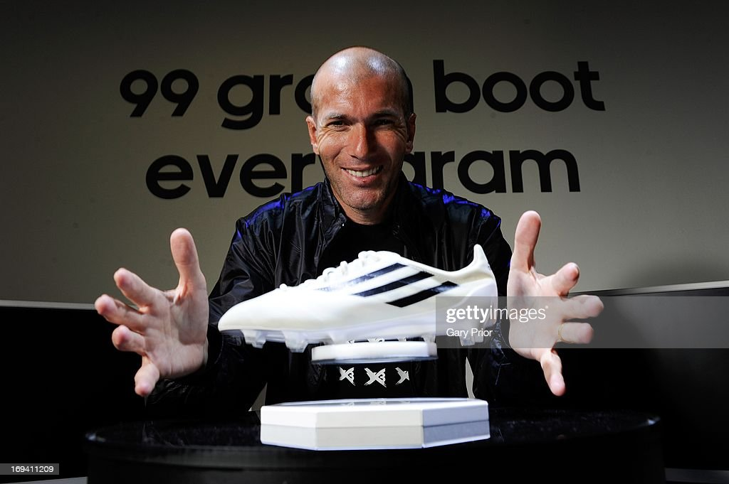 In this handout image provided by adidas, <a gi-track='captionPersonalityLinkClicked' href=/galleries/search?phrase=Zinedine+Zidane&family=editorial&specificpeople=172012 ng-click='$event.stopPropagation()'>Zinedine Zidane</a> poses with the new boot redefining the future of football, weighing only 99 grammes on May 24 in London, England. The world's lightest boot will be released in 2015.