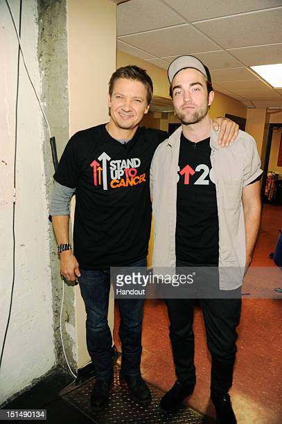 In this handout image provided by American Broadcasting Companies Inc Jeremy Renner and Robert Pattinson attend Stand Up To Cancer at The Shrine...