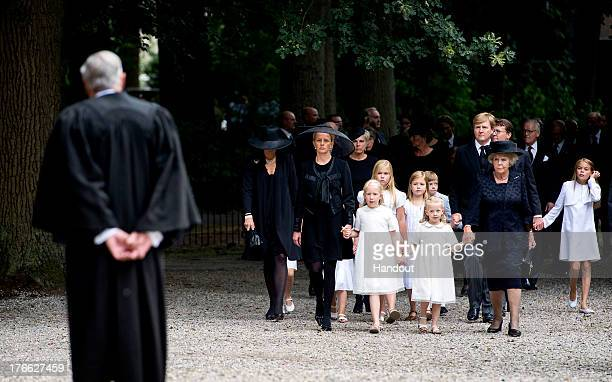 In this handout image provided by ANP Princess Mabel of the Netherlands walks towards Rev Carel ter Linden with her daughters Countess Luana and...