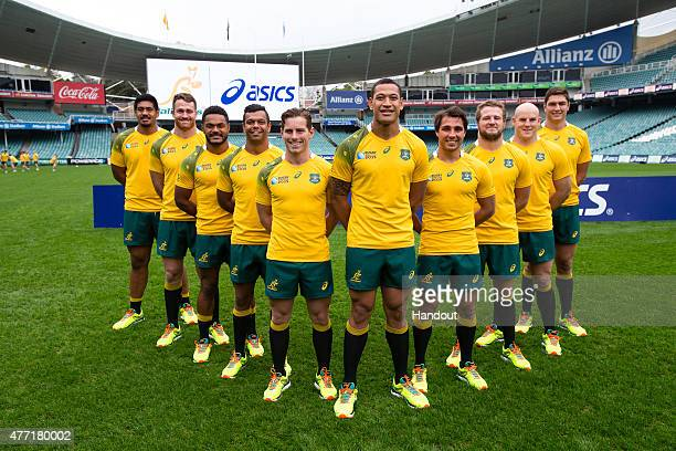 In this handout image provided by ASICS the Wallabies team lineup at the 2015 Australian Wallabies Rugby World Cup jersey launch at Allianz Stadium...