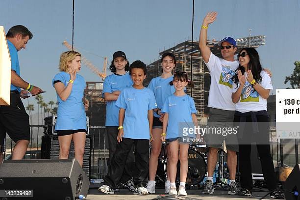 In this handout image provided by Autism Speaks members of the cast of 'Parenthood' and 'General Hospital' stand on stage at the 10th Annual Walk Now...