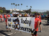 In this handout image provided by Autism Speaks participants of the 10th Annual Walk Now for Autism Speaks pose with a sign at the Rose Bowl on April...