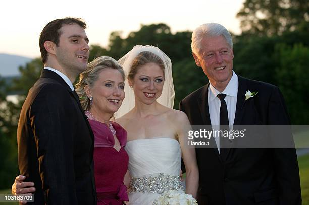 In this handout image provided by Barbara Kinney Marc Mezvinsky US Secretary of State Hillary Clinton Chelsea Clinton and former US President Bill...