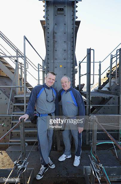 In this handout image provided by BridgeClimb Sydney Michael and Jim Bradfield the great grandson and grandson of civil engineer and bridge designer...