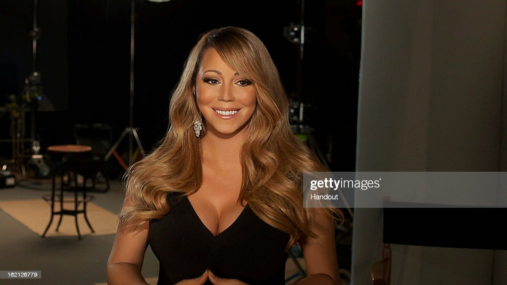 In this handout image provided by CF Publicity, Singer <a gi-track='captionPersonalityLinkClicked' href=/galleries/search?phrase=Mariah+Carey&family=editorial&specificpeople=171647 ng-click='$event.stopPropagation()'>Mariah Carey</a> smiles in an unspecified location on February 13, 2013. Carey has recorded the song, 'Almost Home' for the soundtrack to the Disney feature film 'Oz The Great and Powerful' directed by Sam Raimi in theatres in the US on March 8.