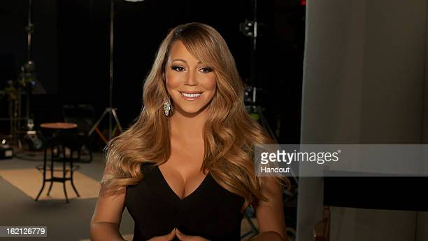 In this handout image provided by CF Publicity Singer Mariah Carey smiles in an unspecified location on February 13 2013 Carey has recorded the song...