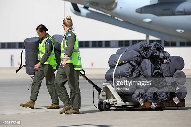In this handout image provided by Commonwealth of Australia crew members load aircraft ready to depart RAAF Base Amberley for the Middle East from...