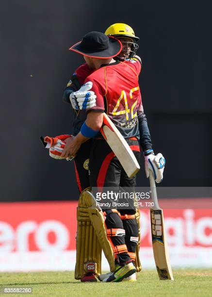 In this handout image provided by CPL T20 Brendon McCullum and Denesh Ramdin of Trinbago Knight Riders hug after winning Match 17 of the 2017 Hero...