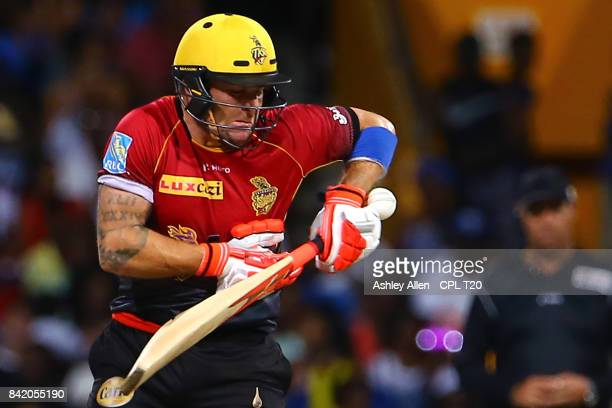 In this handout image provided by CPL T20 Brendon McCullum of the Trinbago Knight Riders is struck on the wrist by a delivery from Wayne Parnell...