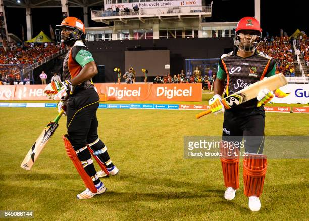 In this handout image provided by CPL T20 Chris Gayle and Evin Lewis of St Kitts Nevis Patriots during the Finals of the 2017 Hero Caribbean Premier...