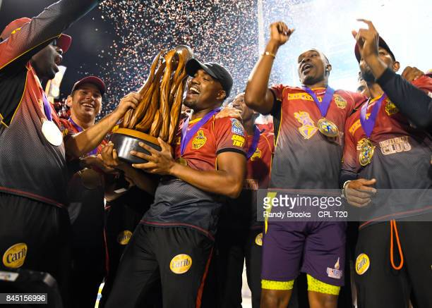 In this handout image provided by CPL T20 Darren Bravo of Trinbago Knight Riders with trophy after the Finals of the 2017 Hero Caribbean Premier...