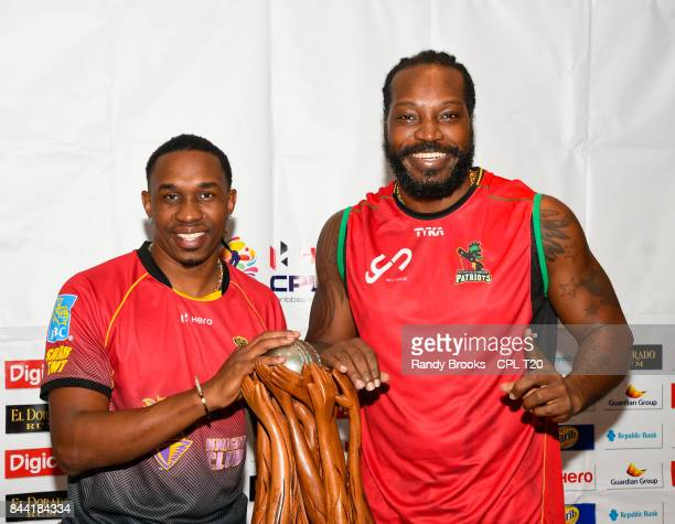 In this handout image provided by CPL T20 Dwayne Bravo of Trinbago Knight Riders and Chris Gayle of St Kitts Nevis Patriots with the trophy during a...