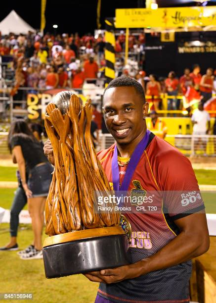 In this handout image provided by CPL T20 Dwayne Bravo of Trinbago Knight Riders with trophy after winning the Finals of the 2017 Hero Caribbean...