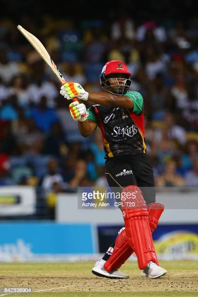 In this handout image provided by CPL T20 Evin Lewis of the St Kitts and Nevis Patriots en route to 97 not out of 33 balls during Match 30 of the...