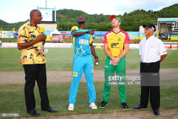 In this handout image provided by CPL T20 From left Commentator Ian Bishop Darren Sammy captain of St Lucia Stars Martin Guptill captain of the...