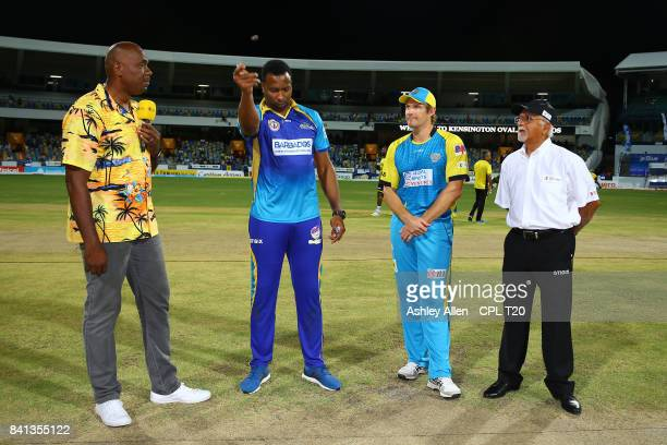 In this handout image provided by CPL T20 From left Commentator Ian Bishop Kieron Pollard captain of Barbados Tridents Shane Watson captain of the St...