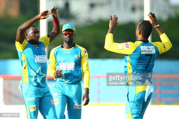 In this handout image provided by CPL T20 From Left Jerome Taylor Andre Fletcher and Marlon Samuels of St Lucia Stars celebrate the dismissal of...